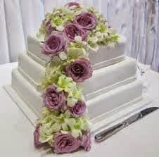 white-cake-with-roses-and-orchids-pughs